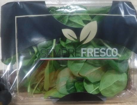 Baby spinach in a plastic package.